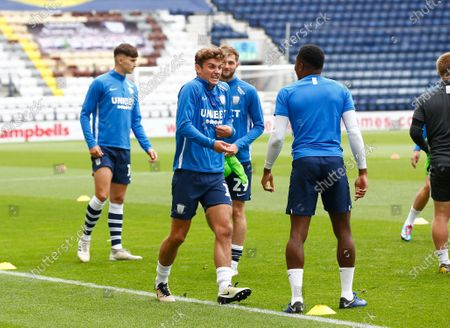 Deepdale Stadium, Preston, Lancashire, England; Ryan Ledson of Preston North End shares a joke with Darnell Fisher during the warm up; English Championship Football, Preston North End versus Nottingham Forest.