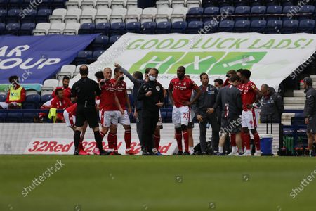 Deepdale Stadium, Preston, Lancashire, England; Players and match officials take the mandatory drinks break midway through the first half; English Championship Football, Preston North End versus Nottingham Forest.