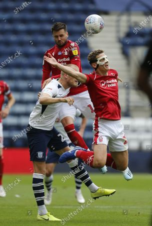 Deepdale Stadium, Preston, Lancashire, England; Ryan Yates of Nottingham Forest is sent flying by a challenge in the back from Jayden Stockley of Preston North End; English Championship Football, Preston North End versus Nottingham Forest.