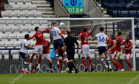 Deepdale Stadium, Preston, Lancashire, England; Patrick Bauer of Preston North End rises above a packed area to get in his header from a Preston corner; English Championship Football, Preston North End versus Nottingham Forest.