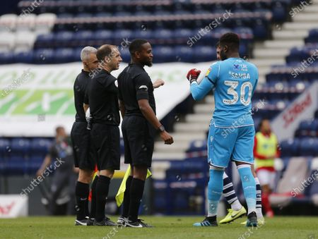 Deepdale Stadium, Preston, Lancashire, England; Nottingham Forest keeper Brice Samba thanks referee Jeremy Simpson and his assistants at the end of the game Strictly; English Championship Football, Preston North End versus Nottingham Forest.