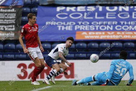 Deepdale Stadium, Preston, Lancashire, England; Nottingham Forest keeper Brice Samba saves at the feet of Sean Maguire of Preston North End as Michael Dawson challenges; English Championship Football, Preston North End versus Nottingham Forest.