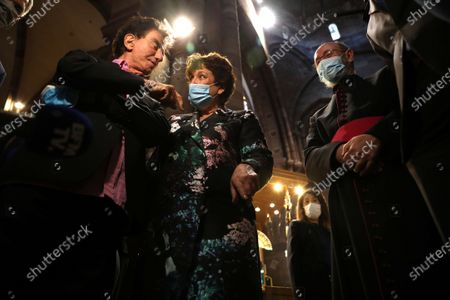 French Culture minister Roselyne Bachelot (C) and former French Culture minister Jack Lang visit Notre-Dame cathedral.