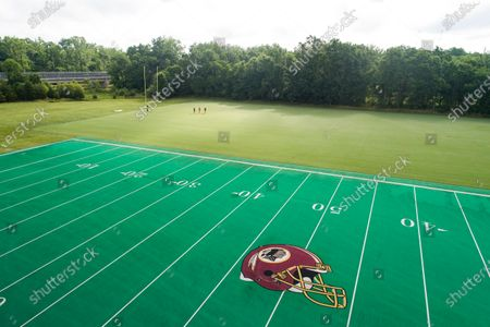 An image made with a drone shows the Washington Redskins logo on a football field at Redskins Park, one of the team's training facilities in Ashburn, Virginia, USA, 10 July 2020. On 03 July, the Redskins announced they are 'reviewing' the team name, which is a dictionary-defined racial slur for Native Americans.