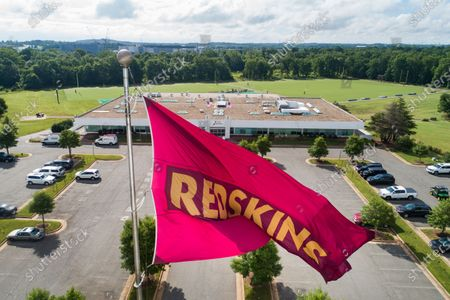 An image made with a drone shows a Washington Redskins flag flying above Redskins Park, one of the team's training facilities in Ashburn, Virginia, USA, 10 July 2020. On 03 July, the Redskins announced they are 'reviewing' the team name, which is a dictionary-defined racial slur for Native Americans.