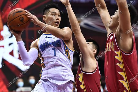 Stock Image of Jeremy Lin (L) of Beijing Ducks goes for a basket during a match between Beijing Ducks and Jilin Northeast Tigers at the 2019-2020 Chinese Basketball Association (CBA) league in Qingdao, east China's Shandong Province, July 10, 2020.