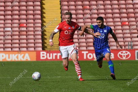 Barnsley's Michael Sollbauer holds off Sam Morsey.