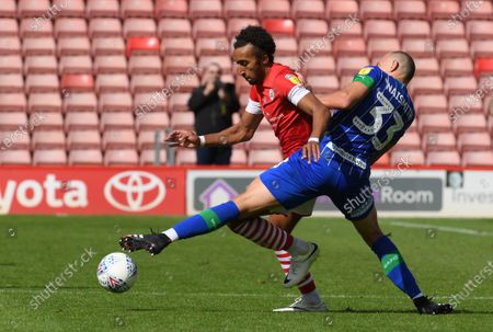 Barnsley's Jacob Brown is fouled by Pal Naysmith.