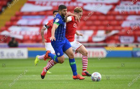 Wigan's Sam Morsey wins the ball from Kilian Ludewig.