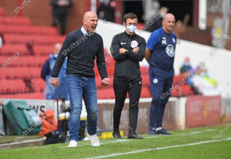 Barnsley's Gerhard Struber shouts the orders as Wigan boss Paul Cook (right) watches on.