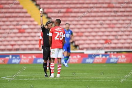 Barnsley's Elliot Simoes receives a yellow card.