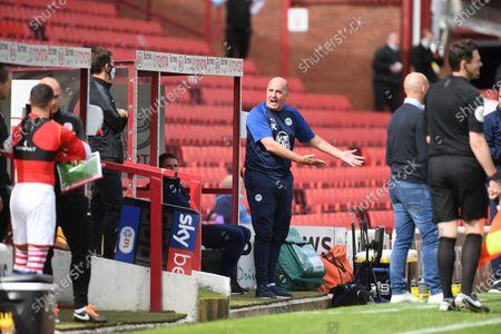 Wigan boss Paul Cook moans again.