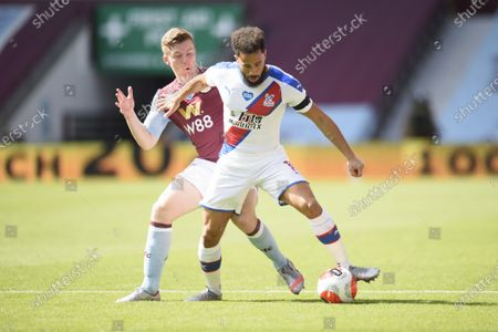 Matt Targett of Aston Villa challenges Andros Townsend of Crystal Palace.