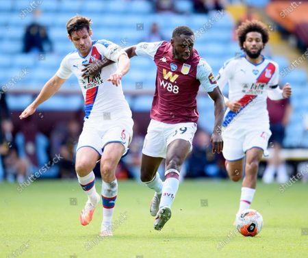 Keinan Davis of Aston Villa is challenged by Scott Dann of Crystal Palace.