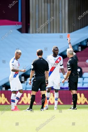 Christian Benteke of Crystal Palace is sent off after the final whistle by referee Martin Atkinson.