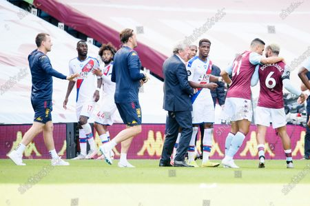 Tempers flare after the final whistle resulting in Christian Benteke of Crystal Palace left being is sent off by referee Martin Atkinson.