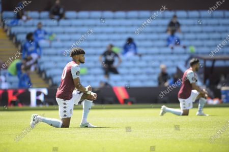 Tyrone Mings of Aston Villa takes a knee.