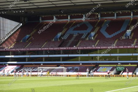 Jack Grealish of Aston Villa takes a free kick in front of an empty stand.