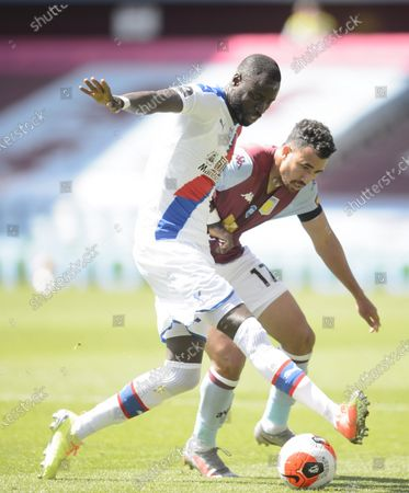 Cheikhou Kouyate of Crystal Palace and Trezeguet of Aston Villa.