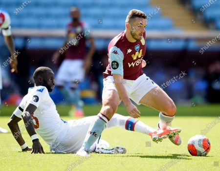 John McGinn of Aston Villa is challenged by Cheikhou Kouyate of Crystal Palace.