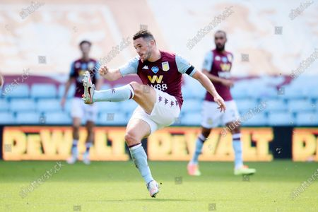 John McGinn of Aston Villa shoots.