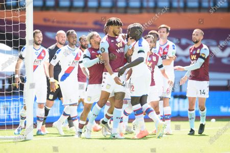 Mamadou Sakho of Crystal Palace squares up to Tyrone Mings of Aston Villa