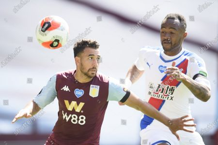 Trezeguet of Aston Villa is challenged by Jordan Ayew of Crystal Palace.