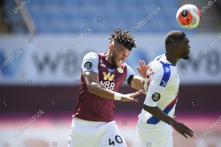 Tyrone Mings of Aston Villa challenges Christian Benteke of Crystal Palace.
