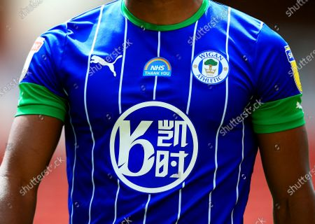 The NHS logo on the Wigan Athletic shirt