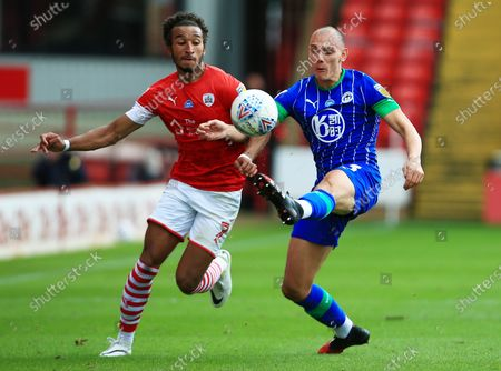 Jacob Brown of Barnsley and Kal Naismith of Wigan Athletic