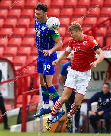 Kieffer Moore of Wigan Athletic and Mads Juel Andersen of Barnsley