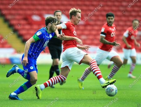 Cauley Woodrow of Barnsley and Joe Williams of Wigan Athletic