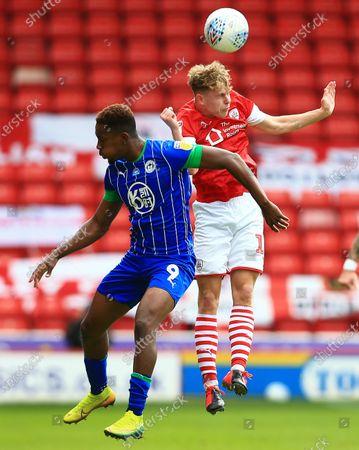 Kilian Ludewig of Barnsley and Jamal Lowe of Wigan Athletic