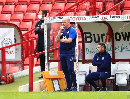 Wigan Athletic manager Paul Cook looks thoughtful