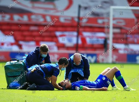 Antonee Robinson of Wigan Athletic receives treatment for a knock
