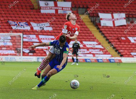 Kilian Ludewig of Barnsley and Antonee Robinson of Wigan Athletic