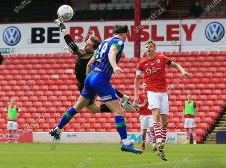Barnsley goalkeeper Jack Walton makes a save from Kieffer Moore of Wigan Athletic
