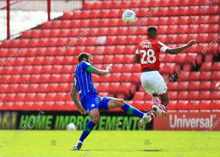 Stock Photo of Danny Fox of Wigan Athletic is shown a red card for this challenge on Elliot Simoes of Barnsley
