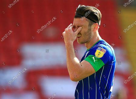 Kieffer Moore of Wigan Athletic looks dejected