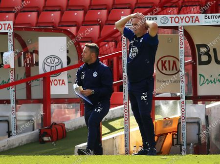Wigan Athletic manager Paul Cook looks dejected