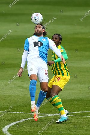 Danny Graham of Blackburn Rovers and West Brom's Romaine Sawyers