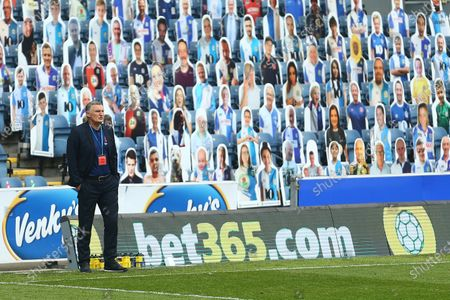 Tony Mowbray, manager of Blackburn Rovers in front of the cardboard cut out fans