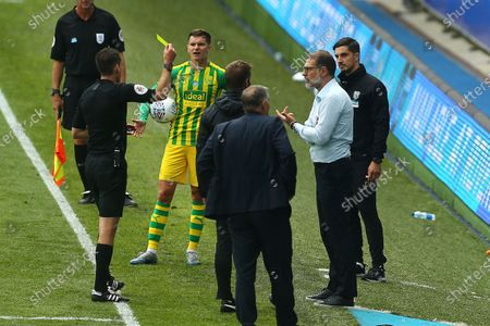 West Brom's manager, Slaven Bilic is shown a yellow card