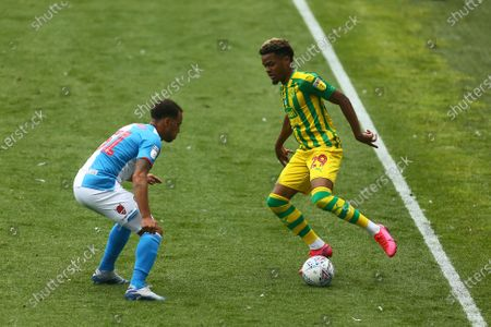 Elliot Bennett of Blackburn Rovers and West Brom's Grady Diangana