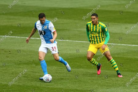 Stewart Downing of Blackburn Rovers and West Brom's Jake Livermore