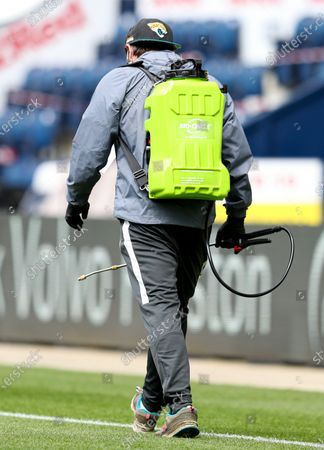 A groundsman with a Bio Circle back pack on