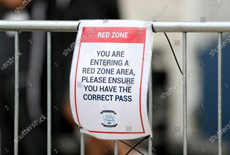 A Coronavirus red zone poster at the ground