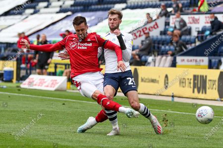 Carl Jenkinson of Nottingham Forest and Tom Barkhuizen of Preston North End