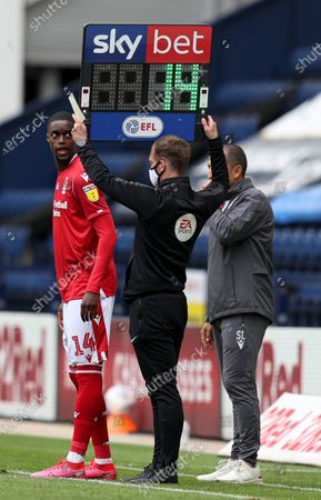 The Sky Bet substitutes board is held up by the fourth official