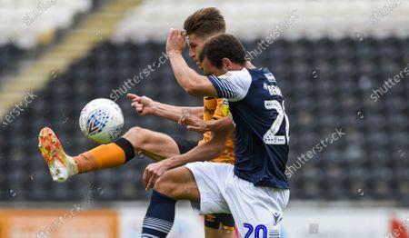 Reece Burke of Hull City and Mason Bennett of Millwall